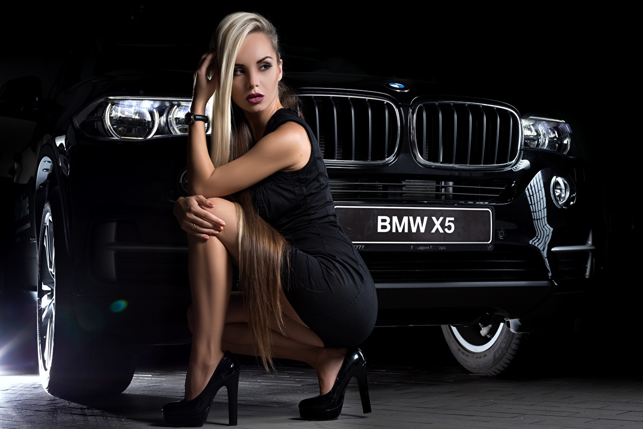 Image BMW Blonde girl x5 Black young woman Legs sit automobile gown high heels Girls female auto Cars Sitting frock Dress Stilettos