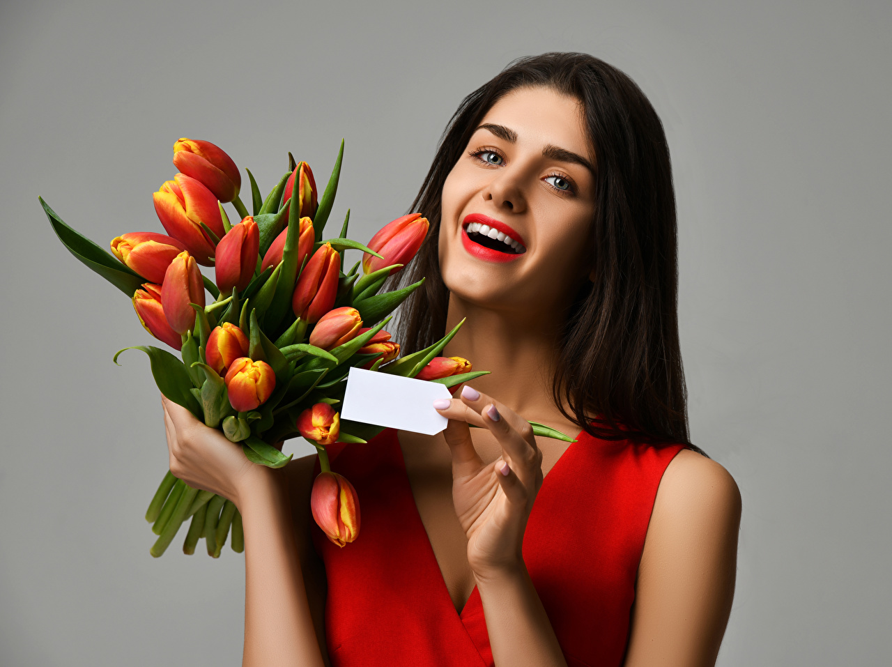 Wallpaper Brown haired happy bouquet Girls Tulips Gray background Joy joyful Bouquets tulip female young woman