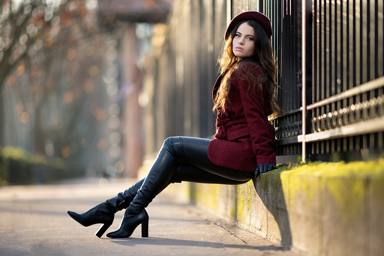 Image Wearing boots blurred background Beret overcoat Girls Legs Staring Bokeh Coat female young woman Glance