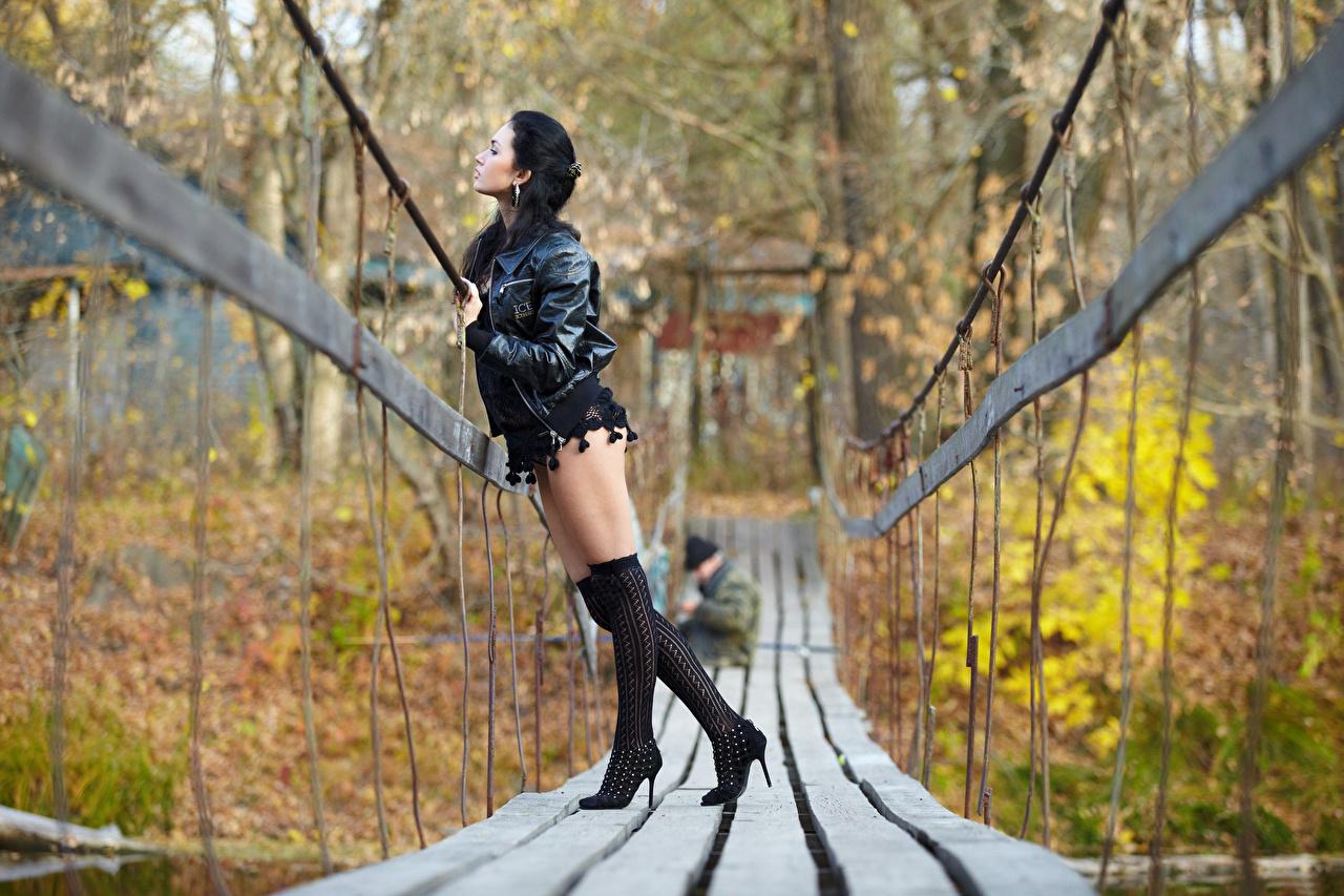 Wallpaper Knee highs Brunette girl blurred background Girls Autumn Jacket Bridges Legs high heels Bokeh bridge female young woman Stilettos