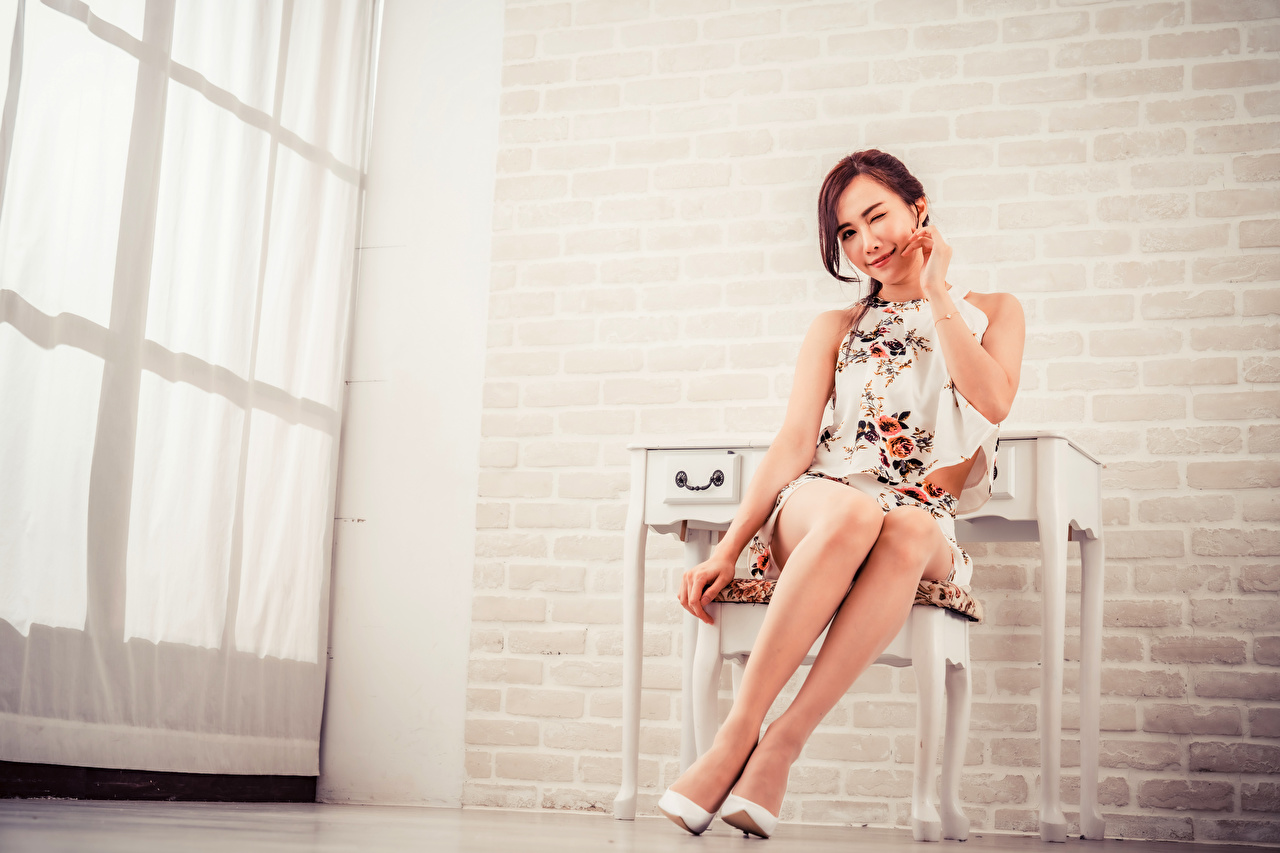 Picture young woman Legs Asiatic sit Staring Stilettos Girls female Asian Sitting Glance high heels