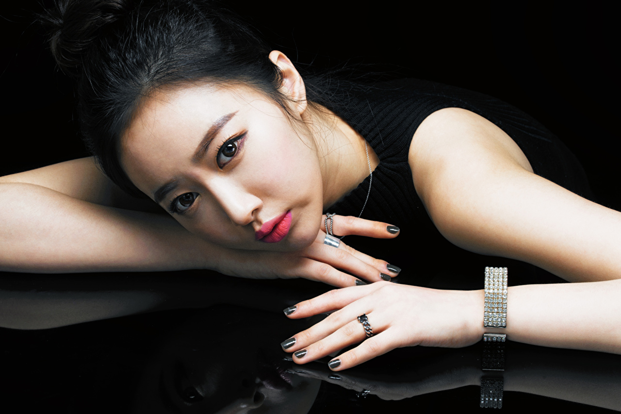 Photo Brunette girl Manicure Makeup young woman Ring Asian Hands Glance Girls female Asiatic jewelry ring Staring