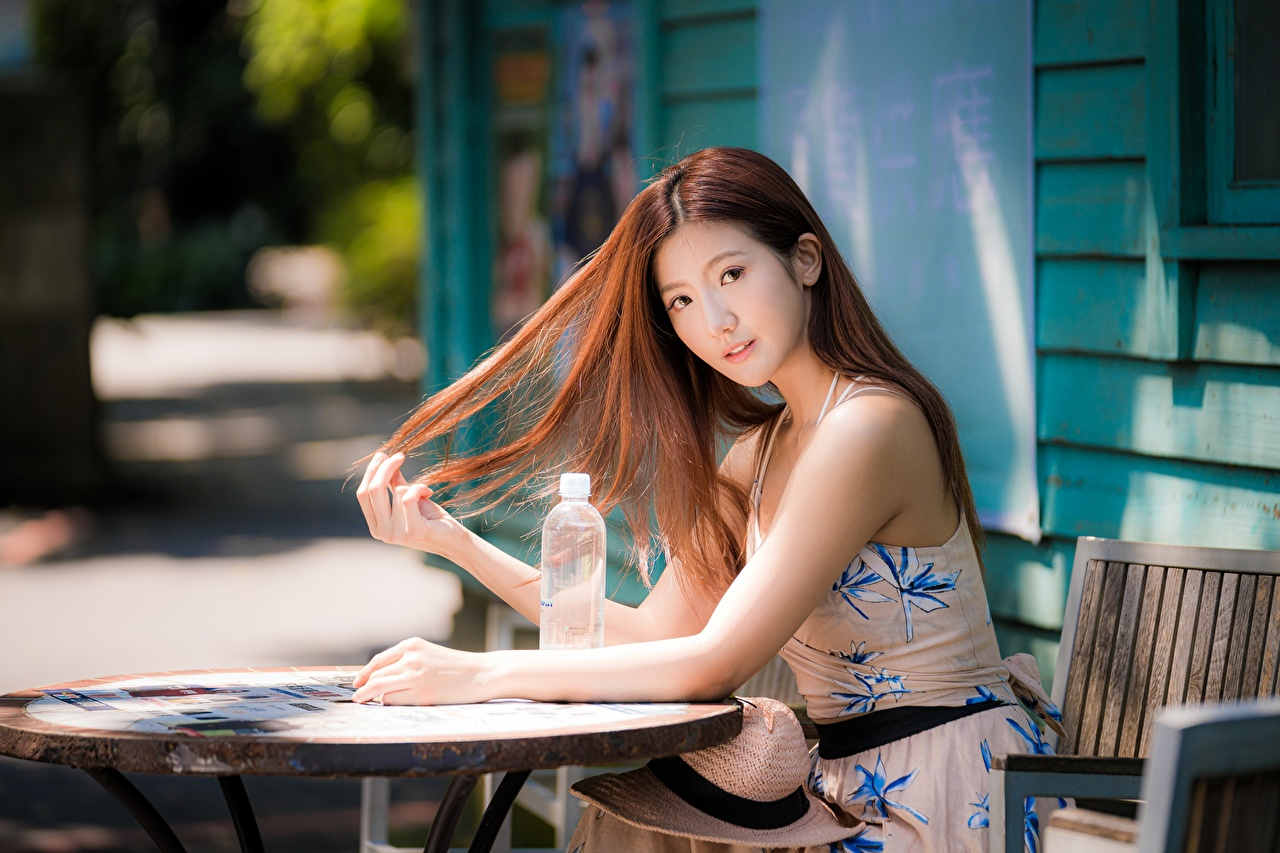 Image Brown haired Bokeh lovely Hair young woman Asiatic Table Sitting Staring Dress blurred background Cute sweet pretty Girls female Asian sit Glance gown frock