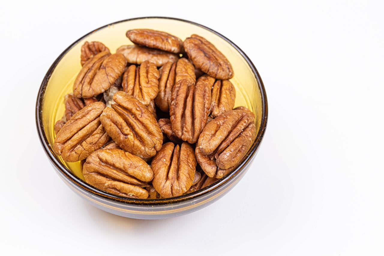 Fotos von pecan Schüssel Lebensmittel Nussfrüchte Weißer hintergrund das Essen Schalenobst