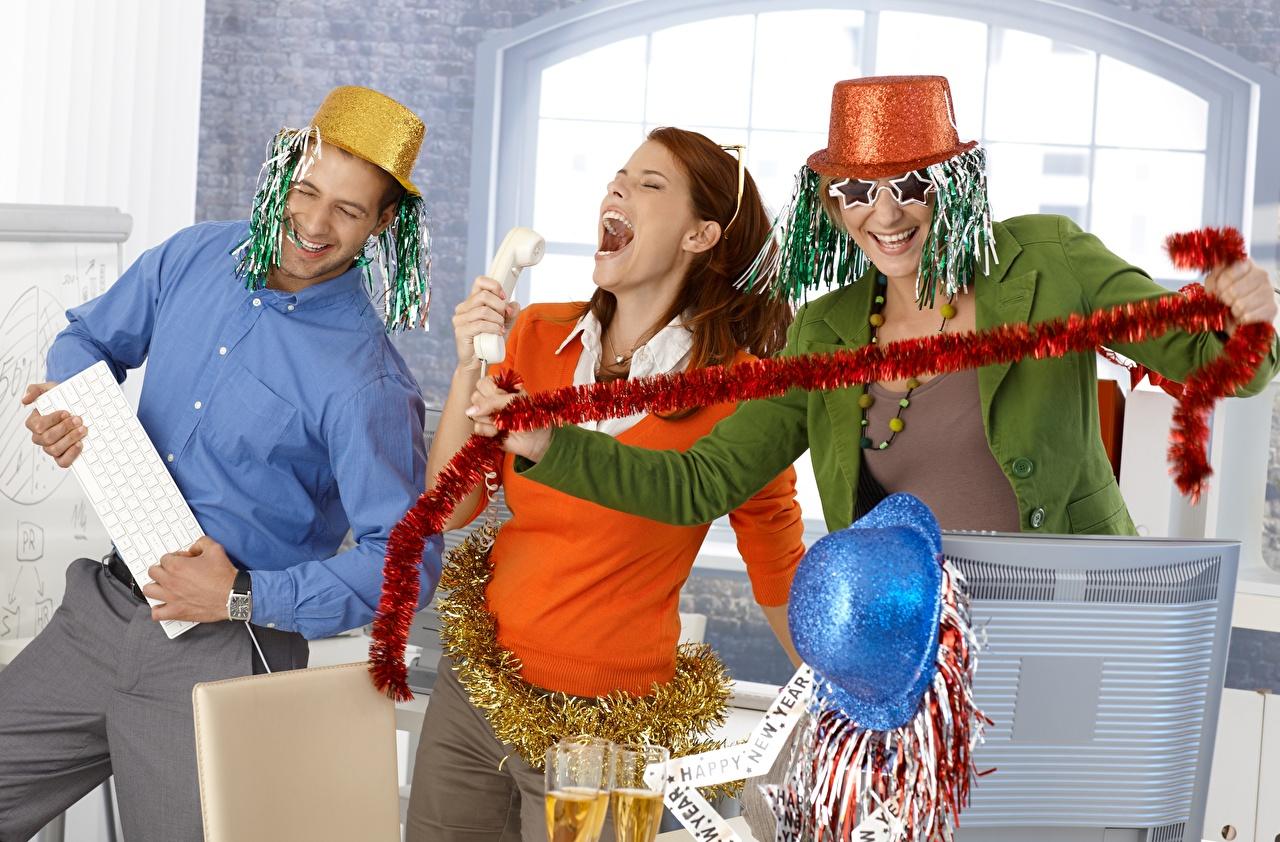 Photo New year Men Smile joyful Funny Hat female Three 3 eyeglasses Holidays Christmas Man Joy happy Girls young woman Glasses