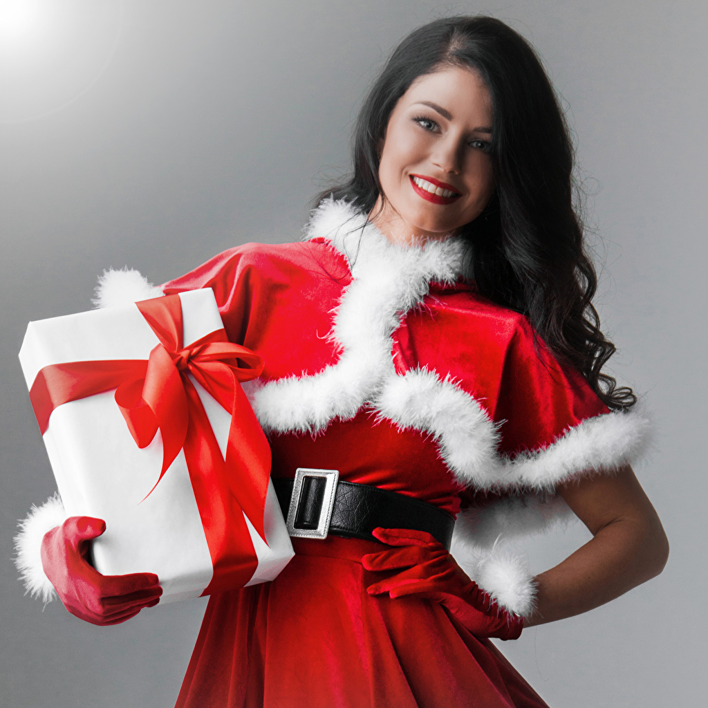Pictures Christmas Brunette girl Smile Girls Gifts Uniform New year female young woman present