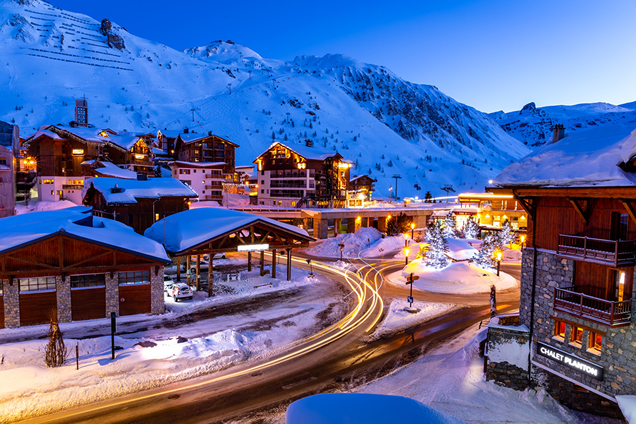 Images France New year Tignes Savoie Winter Mountains Christmas tree Snow Street lights Cities Building Christmas mountain New Year tree Houses