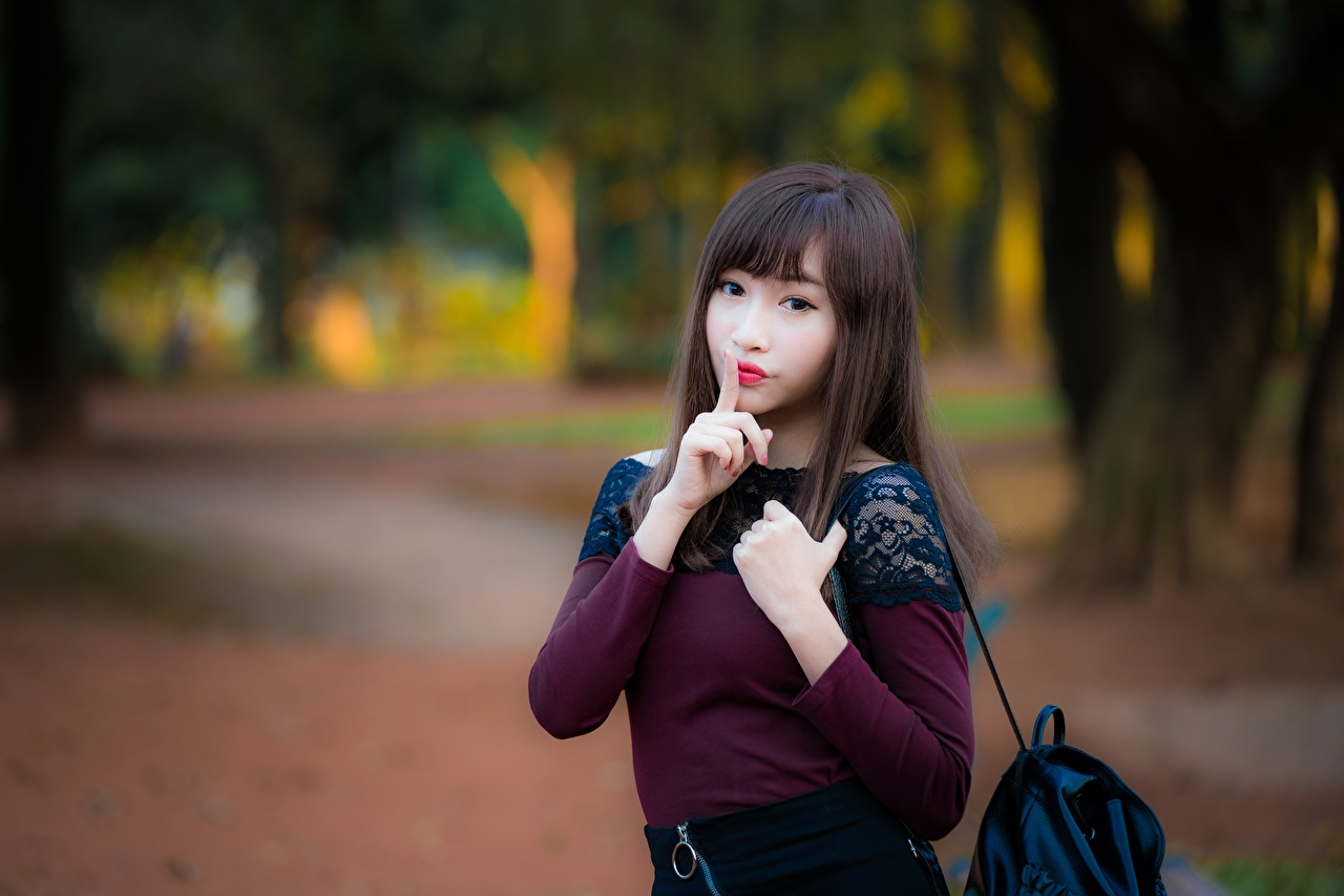 Pictures Brown haired gestures Bokeh female Asiatic Hands Glance Gesture blurred background Girls young woman Asian Staring