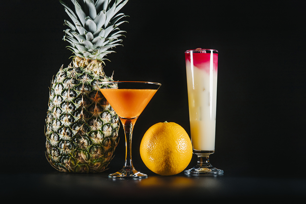Pictures Two Orange fruit Pineapples Highball glass Food Stemware Mixed drink Black background 2 Cocktail