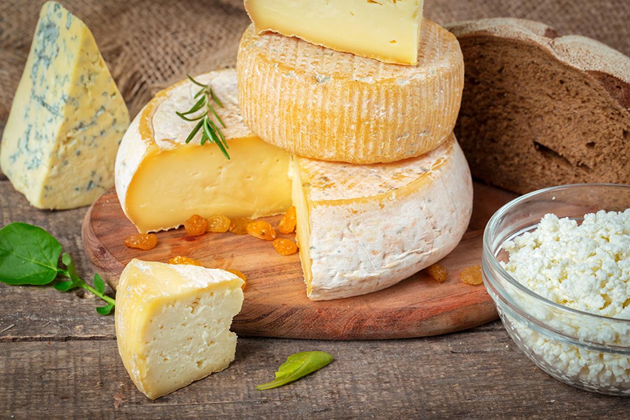 Fotos Käse Stück Lebensmittel Schneidebrett Großansicht