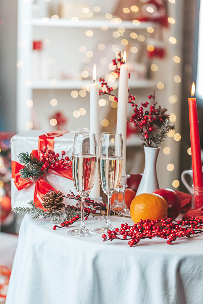 Desktop Wallpapers New year Two Champagne Orange fruit present Food Berry Candles Stemware Branches  for Mobile phone Christmas 2 Sparkling wine Gifts