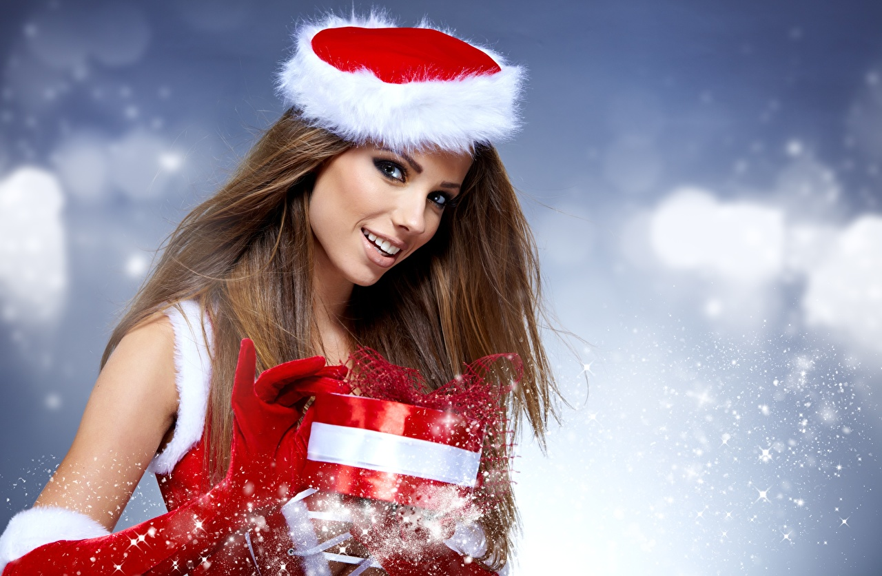 Wallpaper Izabela Magier New year Brown haired Glove Smile Girls present Hands Glance Christmas female young woman Gifts Staring