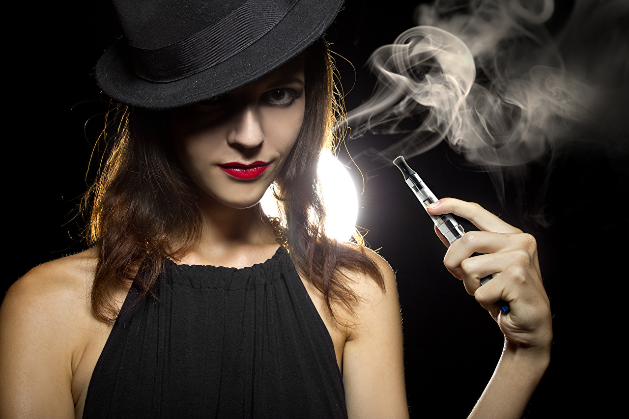 Image Brown haired Electronic cigarette vaping Hat young woman Hands