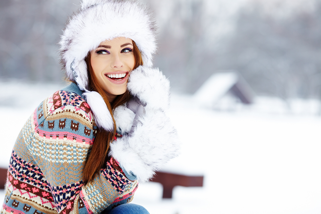 Picture Izabela Magier Brown haired Mittens Smile Bokeh Girls Winter Winter hat Sweater Hands Staring blurred background female young woman Glance