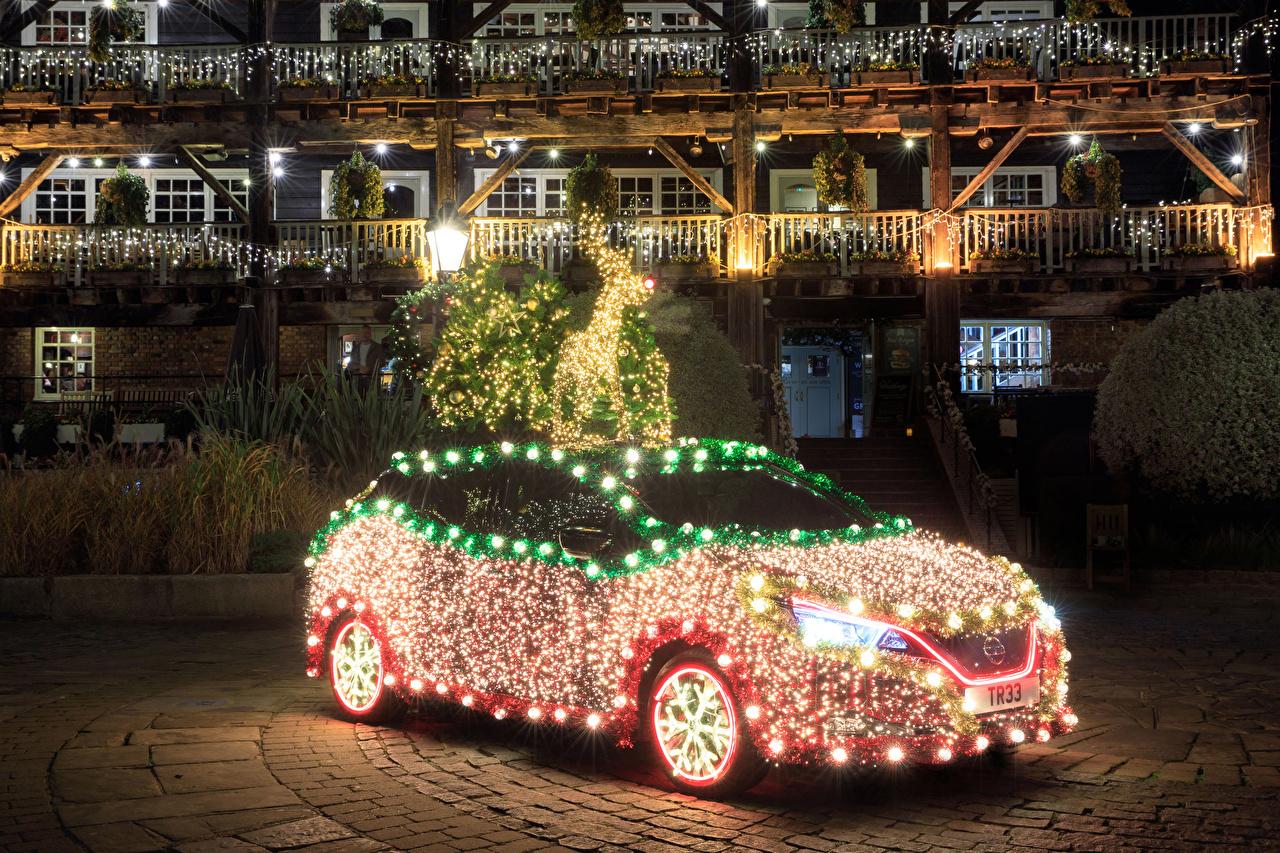 Image Deer Nissan Christmas 2019 Leaf Tree auto Fairy lights New year Cars automobile