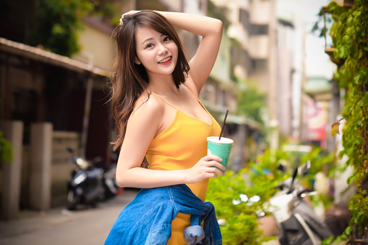Image Brown haired Smile Bokeh posing Girls Asian Highball glass Hands Staring blurred background Pose female young woman Asiatic Glance