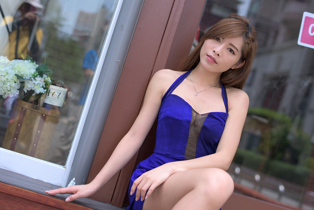 Picture Brown haired young woman Asiatic Hands Glance gown Girls female Asian Staring frock Dress