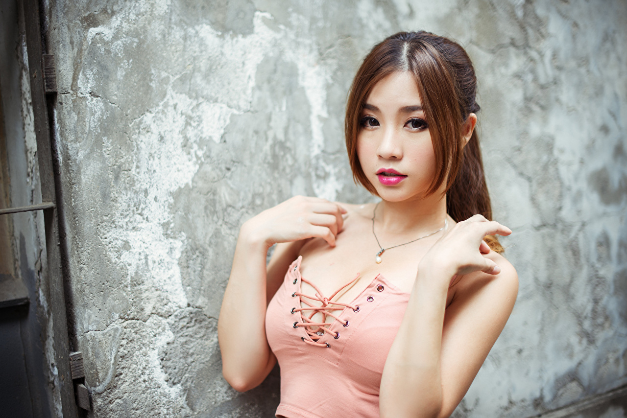 Images Girls Asian Singlet Wall Hands Glance female young woman Asiatic Sleeveless shirt walls Staring