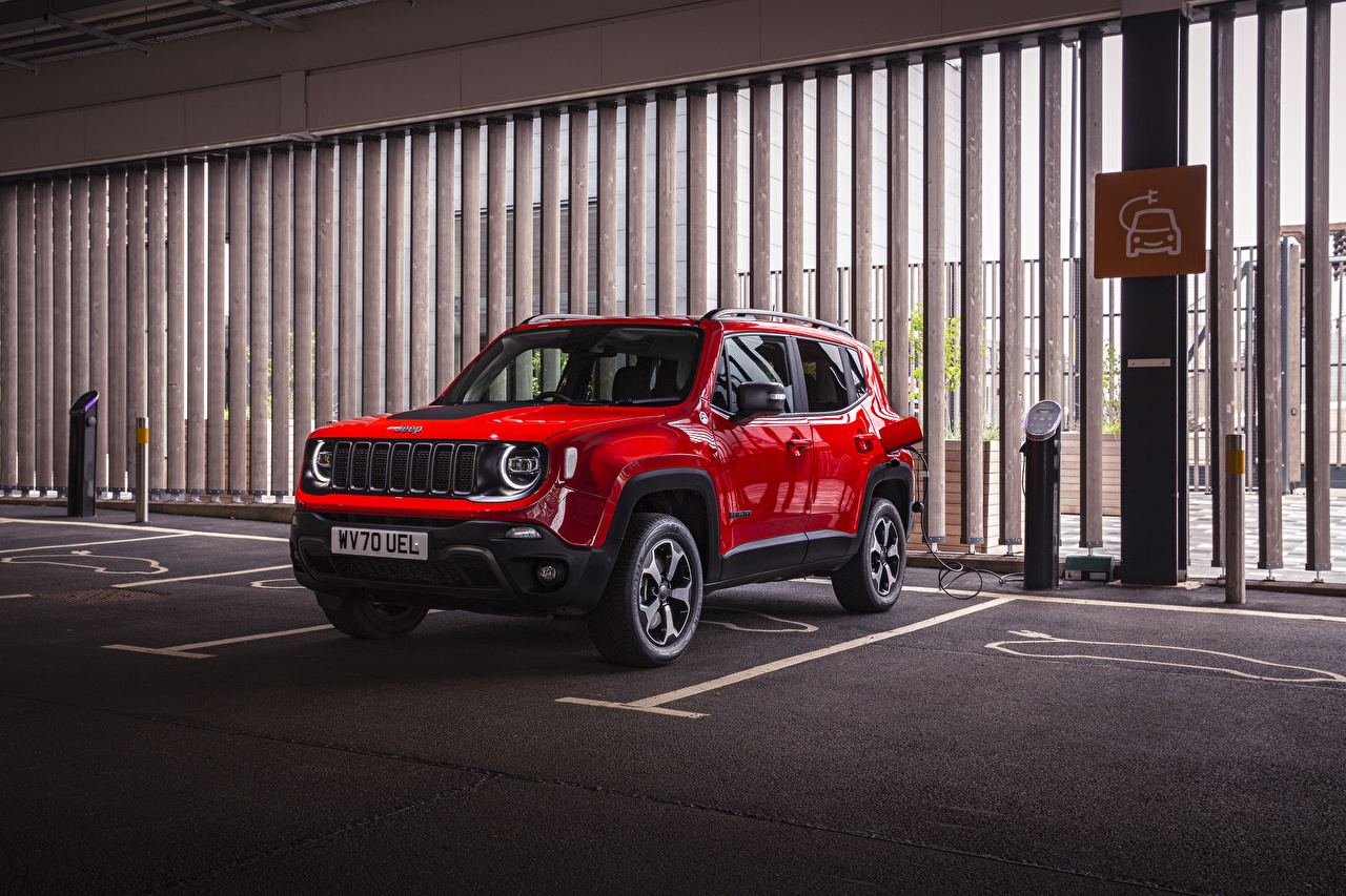 Photo Jeep Sport utility vehicle 2020 Renegade Trailhawk 4xe parked Hybrid vehicle Red auto Metallic SUV Parking Cars automobile