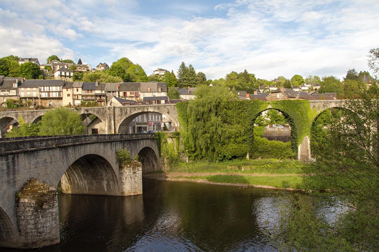 Pictures France Uzerche bridge river Trees Houses Cities Bridges Rivers Building