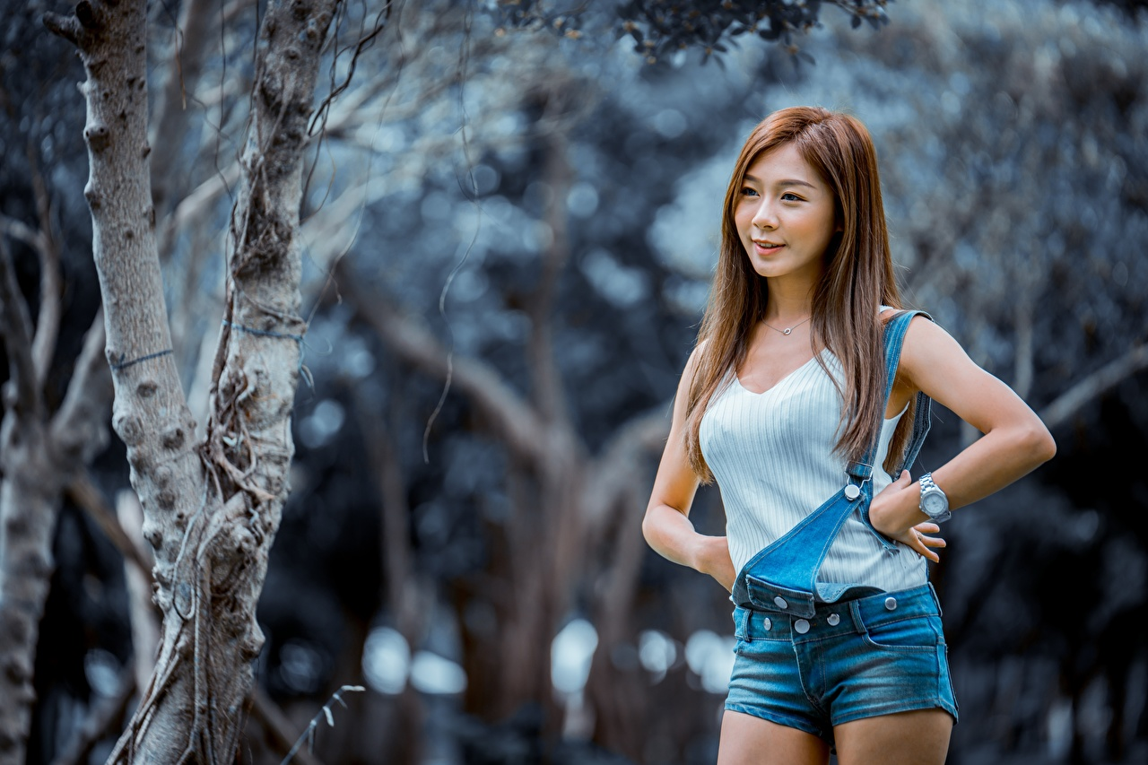 Photos Brown haired Bokeh Pose female Asian Hands Shorts blurred background posing Girls young woman Asiatic