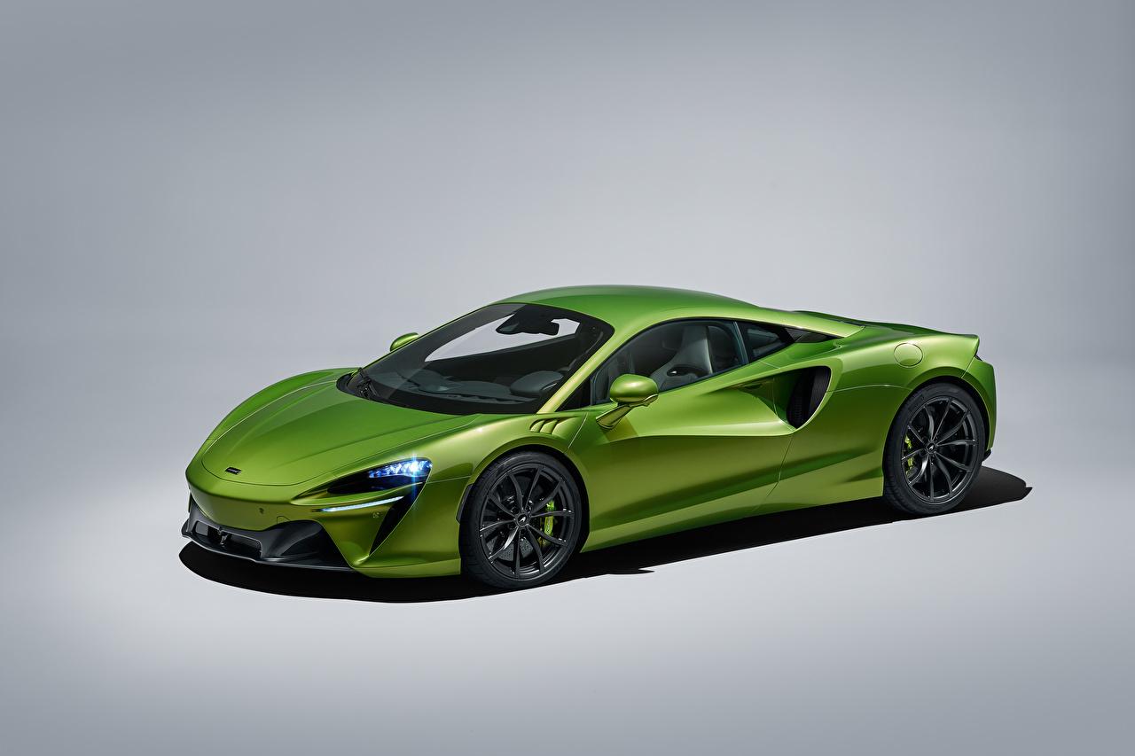 Foto McLaren Artura, Worldwide, 2021 Verde metallico autovettura Sfondo grigio Auto macchina macchine automobile Metallizzato