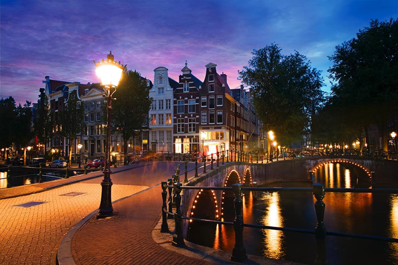 Photo Amsterdam Netherlands Keizersgracht Canal bridge Evening Street lights Cities Building Bridges Houses