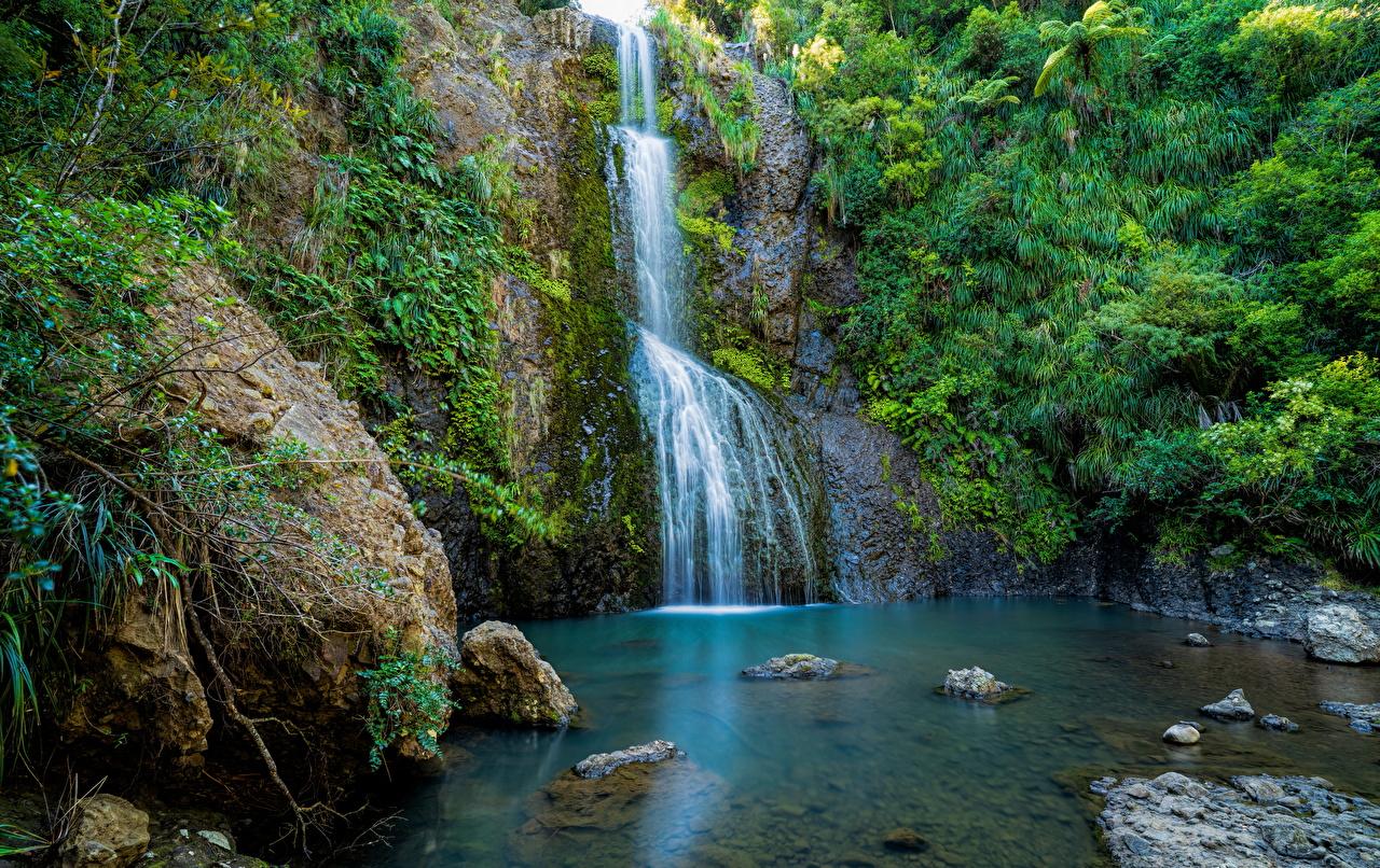 Pictures New Zealand Kitekite Falls Crag Nature Waterfalls stone Rock Cliff Stones