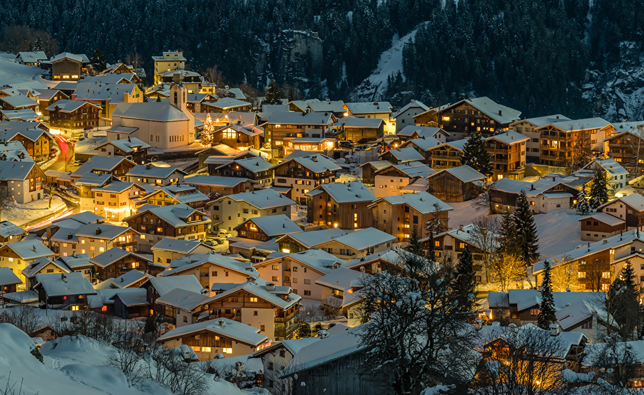 Photos Switzerland Canton of Grisons Roof Winter Snow night time From above Houses Cities Night Building