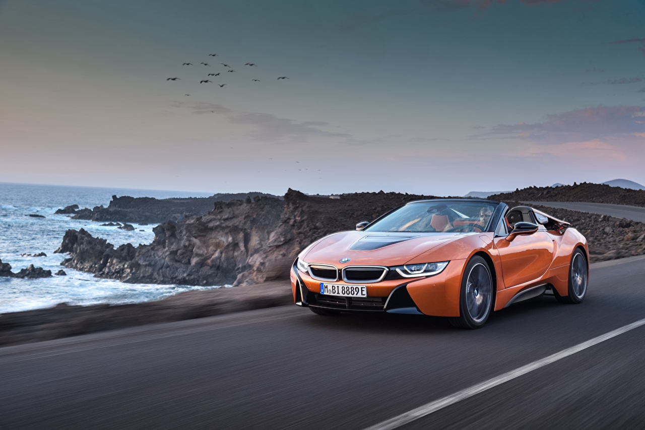 Pictures BMW 2018 i8 Roadster Orange driving automobile moving riding Motion at speed Cars auto