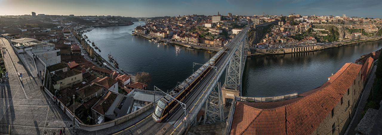 Fotos von Porto Portugal Panorama river Douro Brücken Züge Fluss Städte Gebäude Panoramafotografie Brücke Flusse Haus