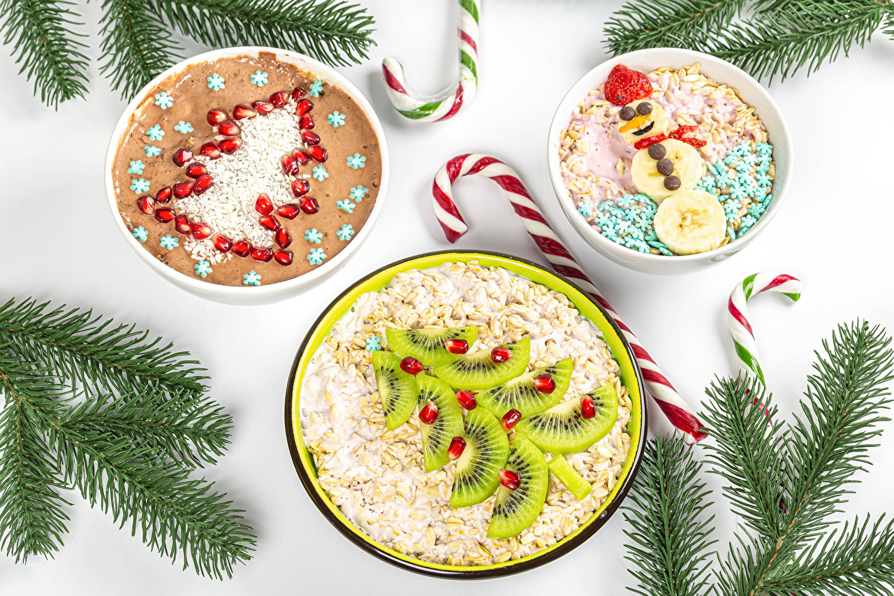 Photos Christmas Oatmeal Lollipop New Year tree Snowman Creative Kiwifruit Pomegranate Food Muesli Branches White background New year Christmas tree Kiwi Snowmen Chinese gooseberry