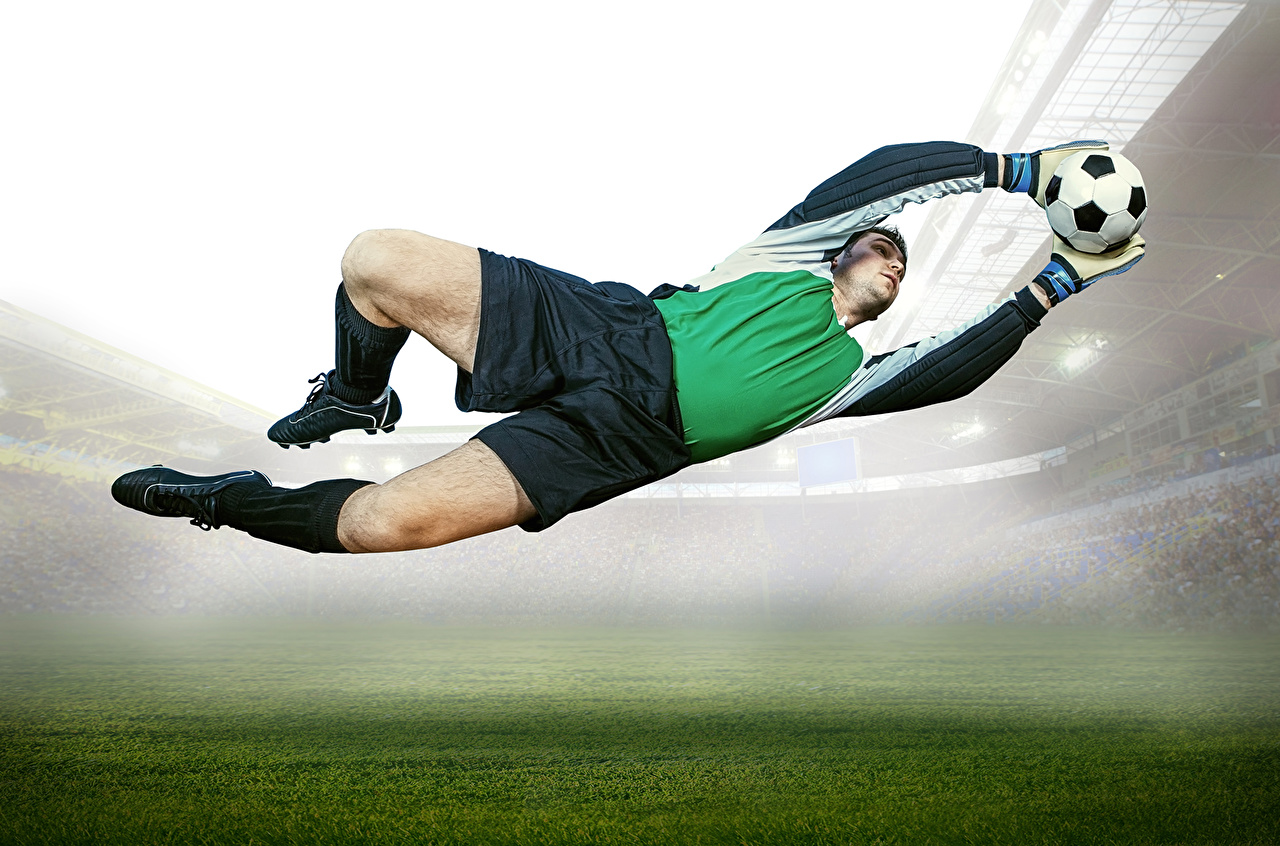 Pictures Men Goalkeeper (football) Sport Footbal Jump Legs Ball
