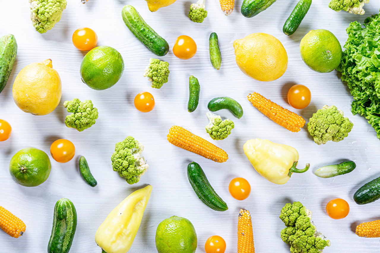 Photo Food Corn Lime Tomatoes Cucumbers Lemons Vegetables Bell pepper White background Broccoli