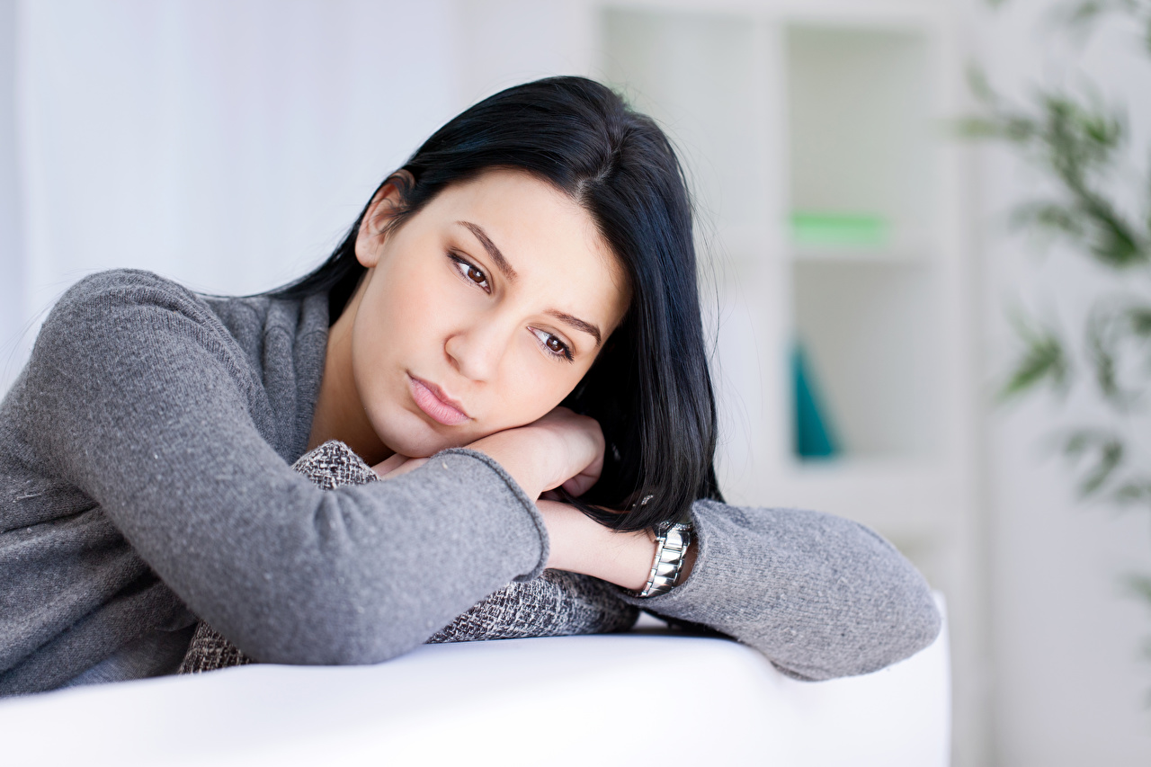 Image Brunette girl sorrow Bokeh female Sweater Hands Glance sad gloomy Sadness blurred background Girls young woman Staring