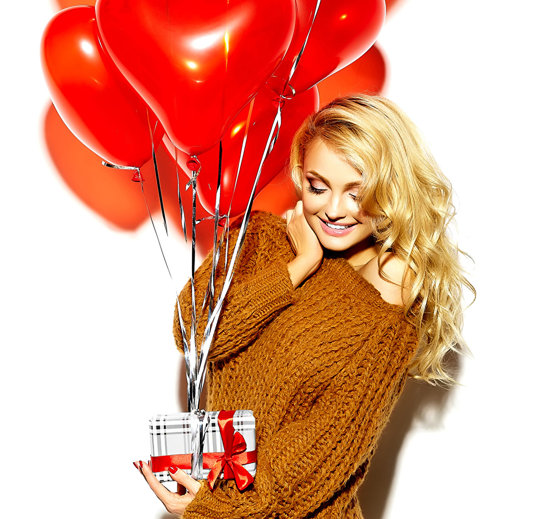 Photo Valentine's Day Blonde girl Smile balloons young woman Gifts Sweater White background Toy balloon Girls female present