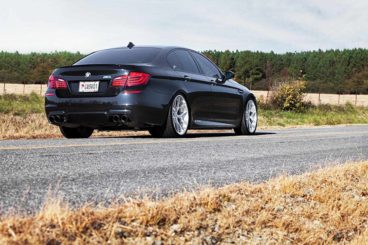 Wallpaper BMW m5 f10 Black auto Asphalt Back view Cars automobile