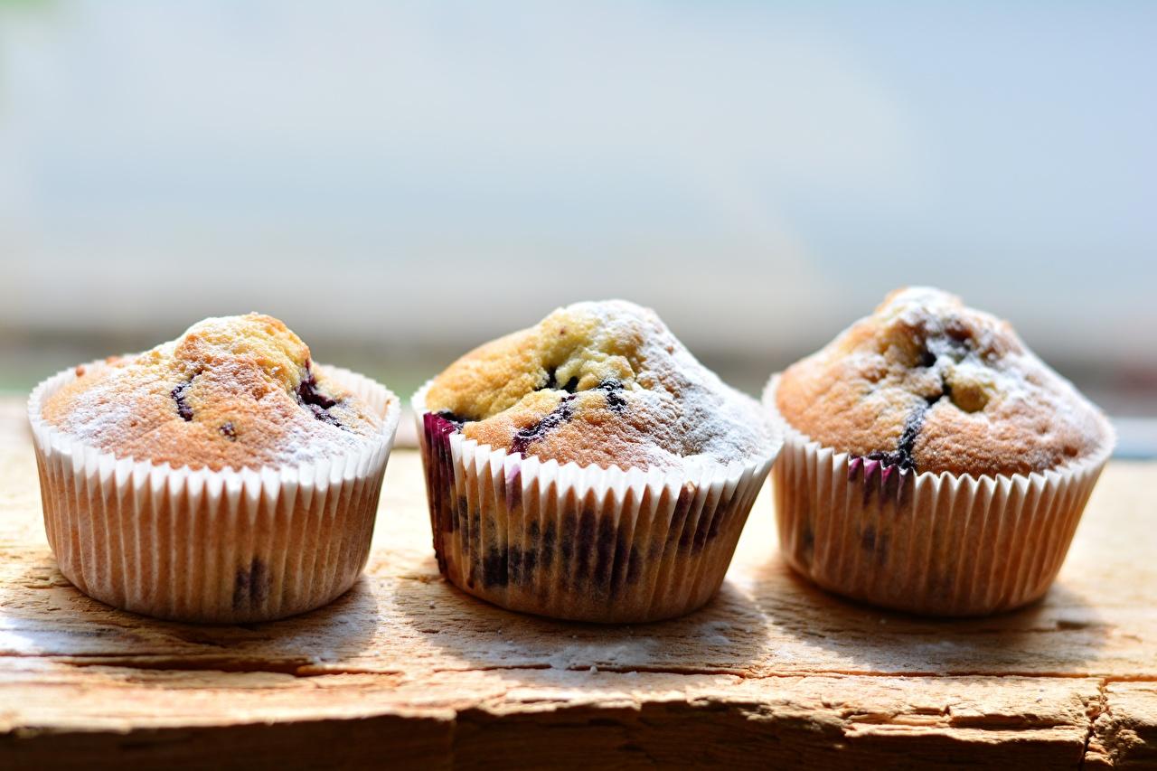 Fotos Bokeh Keks Muffin Puderzucker Drei 3 Lebensmittel Backware unscharfer Hintergrund das Essen