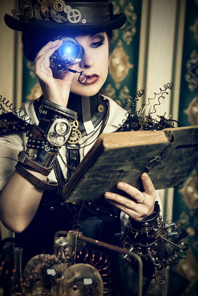 Foto Steampunk Blondine zahnräder Der Hut Mädchens Hand Bücher  für Handy Blond Mädchen Zahnrad junge frau junge Frauen Buch