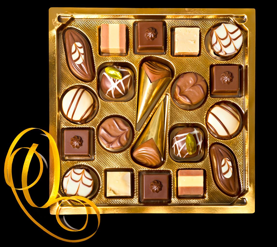 Bilder von Schokolade Bonbon Schachtel Lebensmittel Süßigkeiten Schwarzer Hintergrund Design Süßware