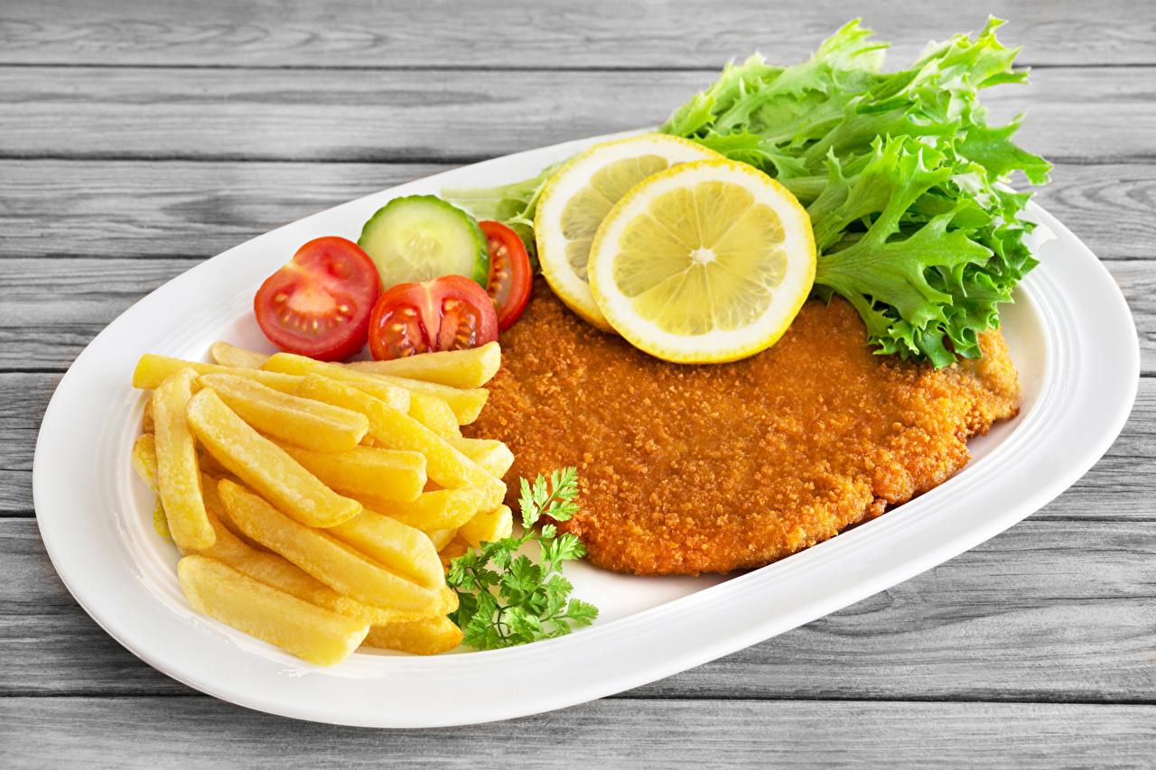 Bilder von Fritten Zitrone Fast food Teller Gemüse Lebensmittel Lebensmittel Fleischwaren Pommes frites