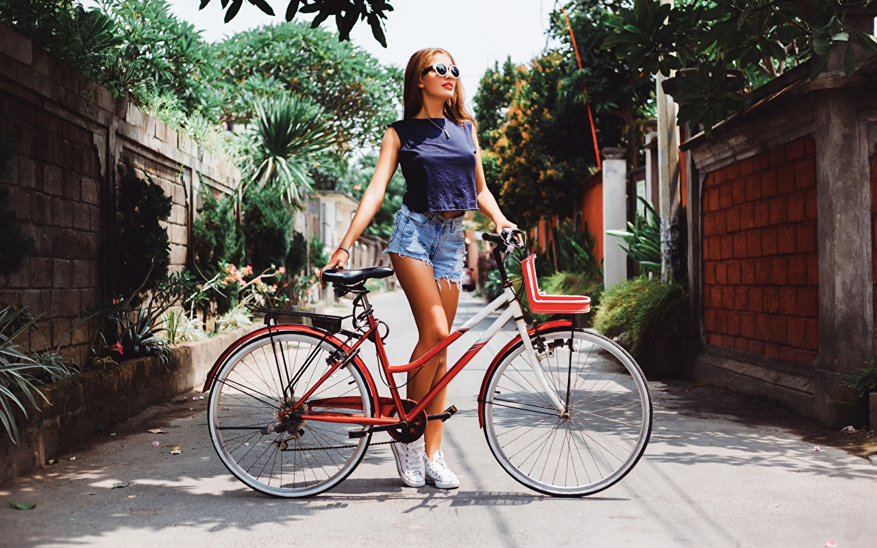 Images Bicycle Girls Shorts eyeglasses bike bicycles female young woman Glasses