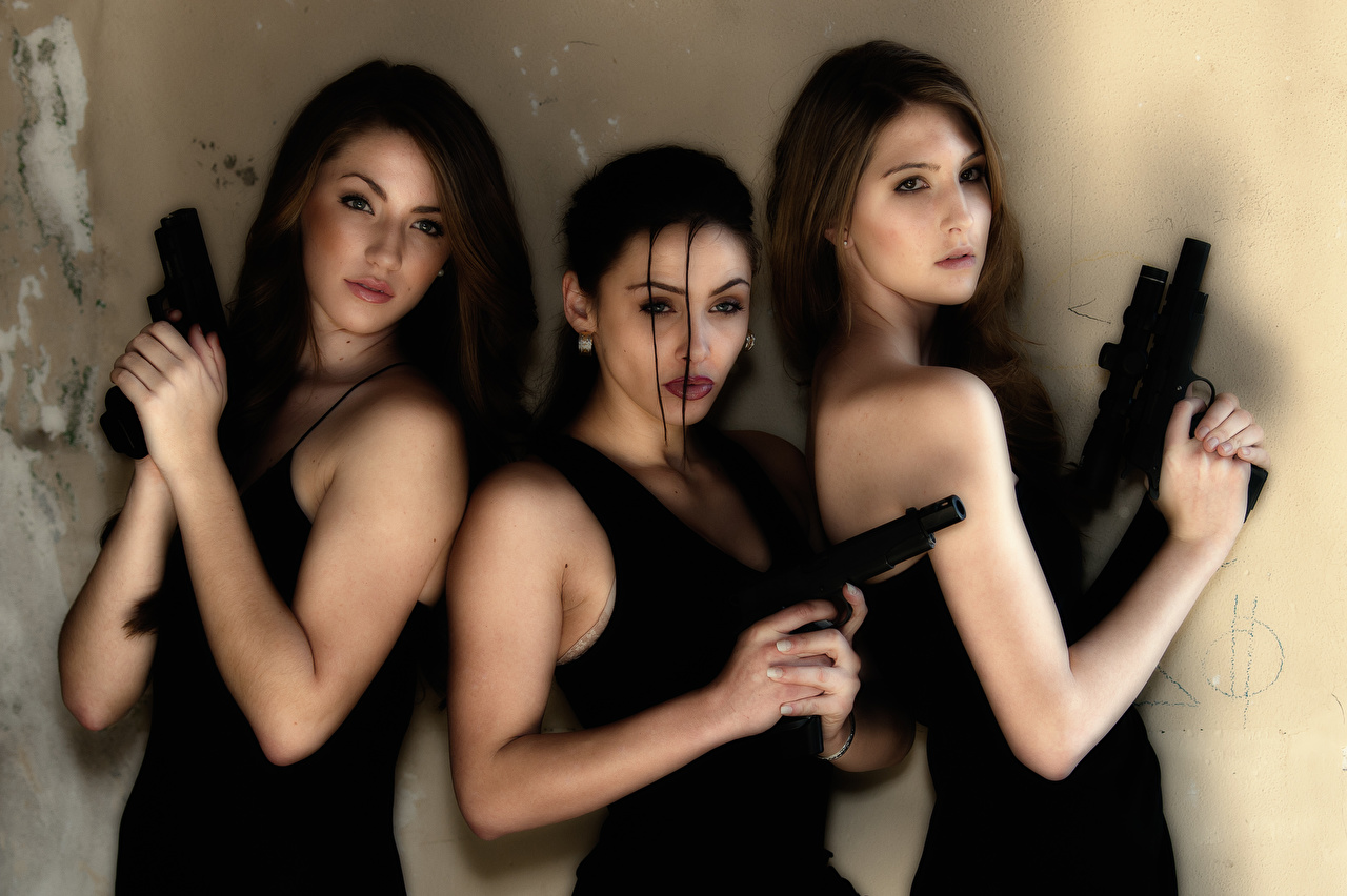 Picture pistol Brunette girl female Hands Three 3 Glance Pistols Girls young woman Staring