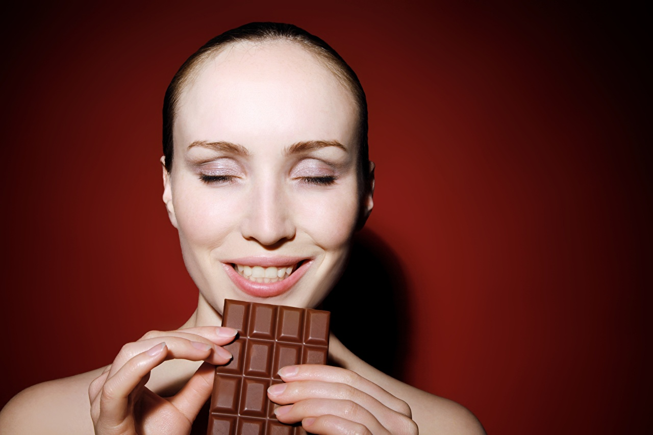 Picture Joy Smile Chocolate bar Chocolate Face young woman Fingers Colored background happy joyful Girls female