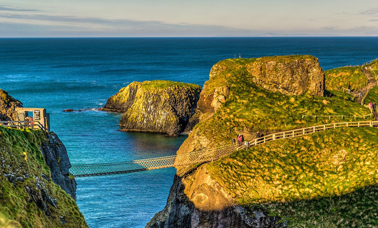 Photo United Kingdom Ballintoy Northern Ireland Sea Cliff bridge Nature Coast Rock Crag Bridges