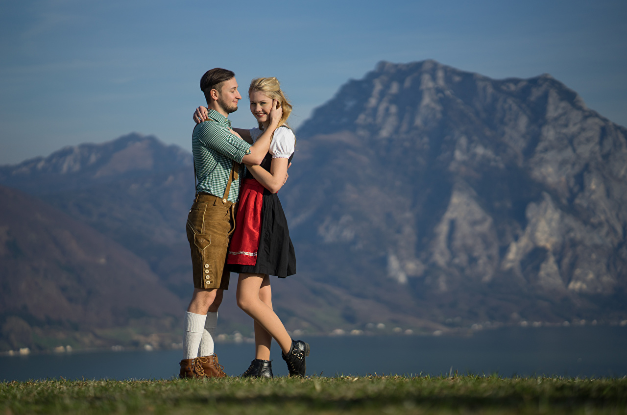 Pictures Waitress Blonde girl Smile guys blurred background embrace young woman Hands Uniform guy Young man teenage guy Bokeh Hug hugs Girls female hugging