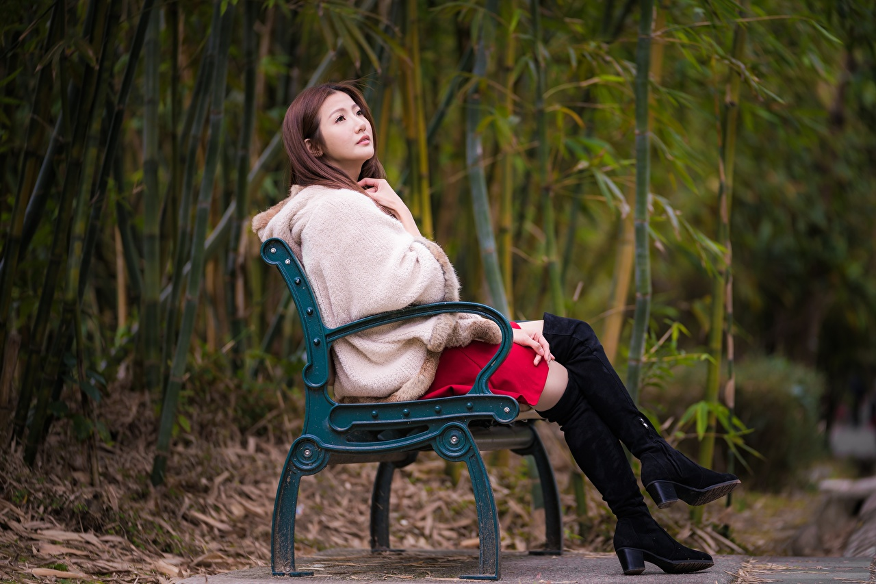 Image Brown haired Fur coat Wearing boots female Legs Asian Bench Sitting Girls young woman Asiatic sit