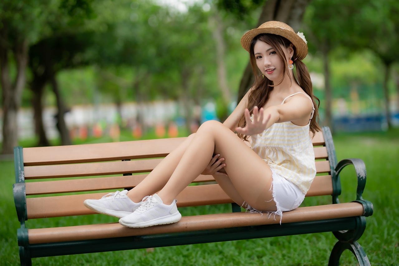 Image Brown haired Bokeh Beautiful Hat Girls Legs Asian sit Hands Bench blurred background female young woman Asiatic Sitting