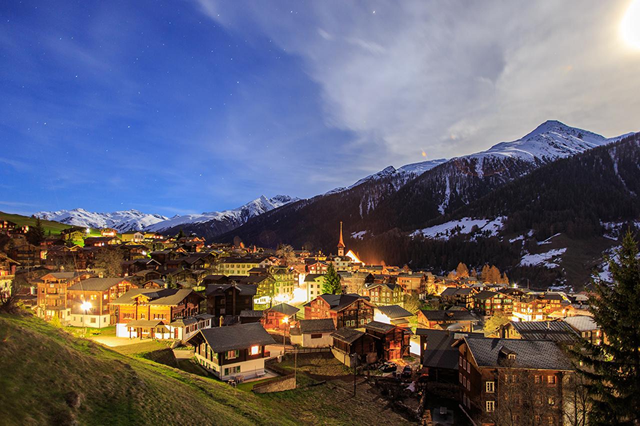Foto Svizzera Munster Goms Montagne Di notte Città La casa montagna Notte notturna edificio