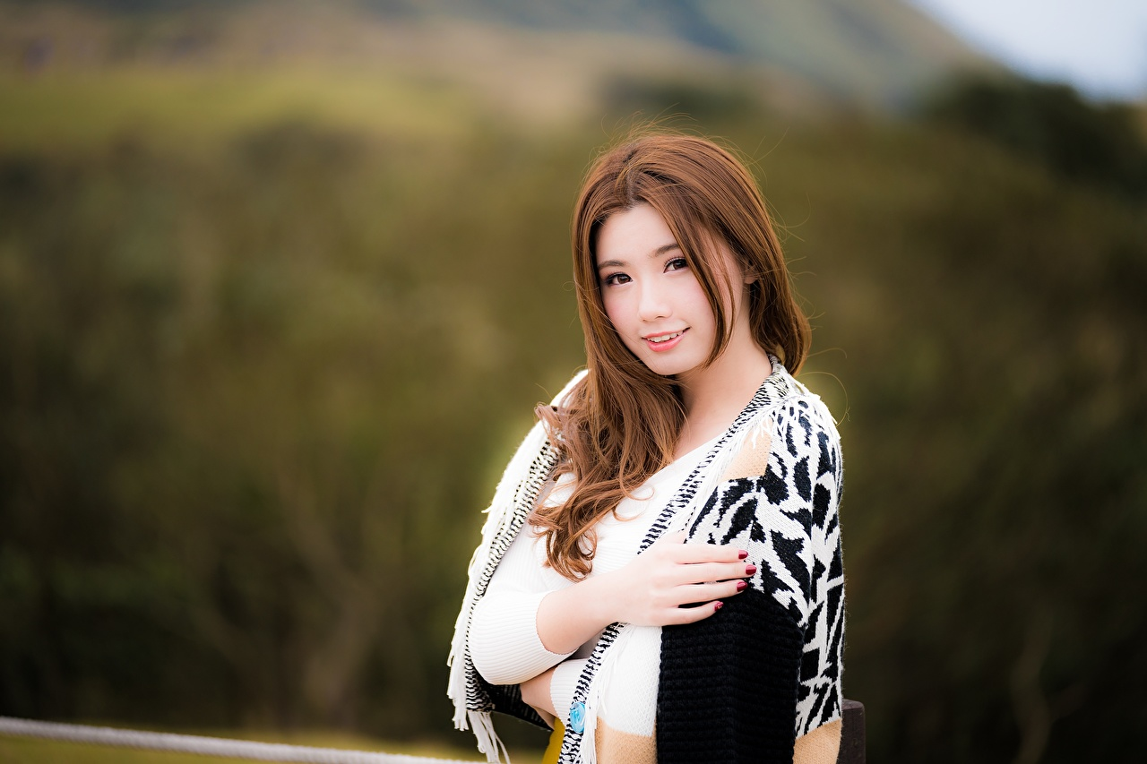 Photos Brown haired blurred background Girls Asiatic Hands Staring Bokeh female young woman Asian Glance